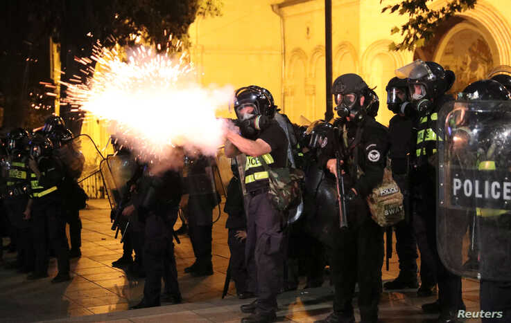 A riot policeman fires during a rally against a Russian lawmaker's visit in Tbilisi, Georgia, June 21, 2019.