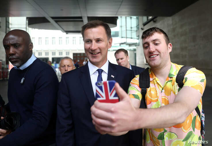 Jeremy Hunt, a leadership candidate for Britain's Conservative Party, leaves BBC studios in London