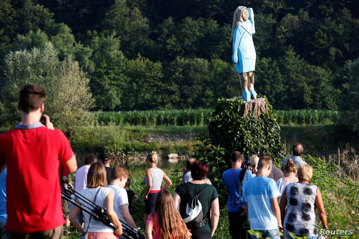 Life-size wooden sculpture of U.S. first lady Melania Trump is officially unveiled in Rozno, near her hometown of Sevnica