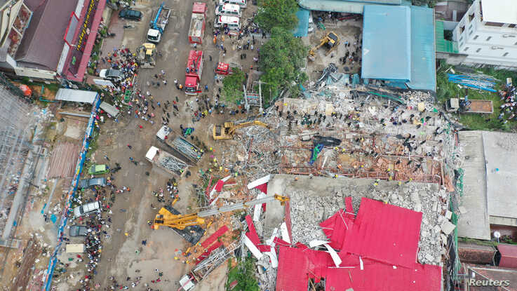 General view of a collapsed under-construction building in Sihanoukville