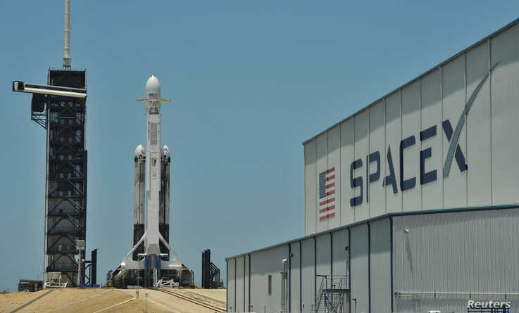 FILE PHOTO: A SpaceX Falcon Heavy rocket, carrying the U.S. Air Force's Space Test Program-2 mission, is shown during launch preparation at the Kennedy Space Center in Cape Canaveral