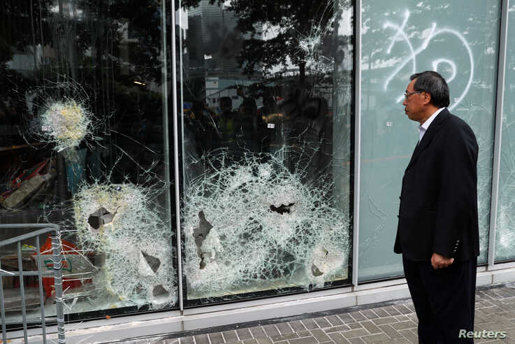Andrew Leung, president of the Legislative Council, looks at damaged glass panels, a day after protesters broke into the council building, in Hong Kong, July 2, 2019.