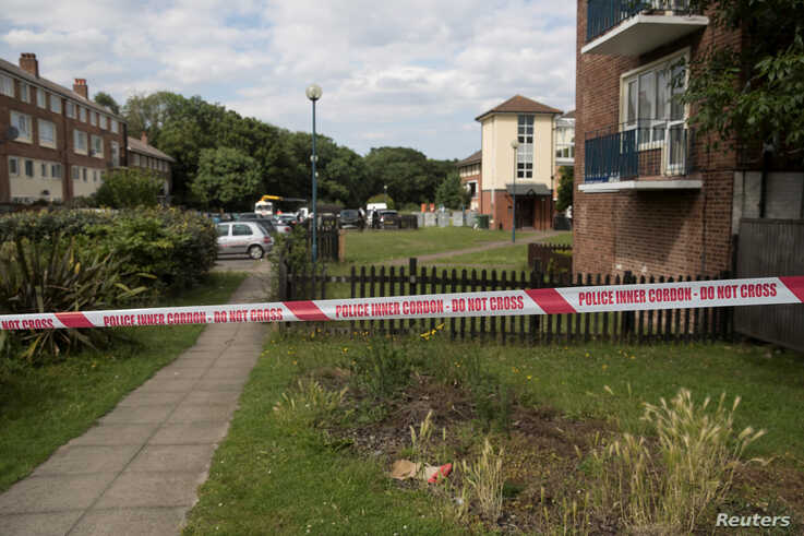 Police cordon tape is seen at the scene of a fatal shooting at Exeter House in Feltham, London