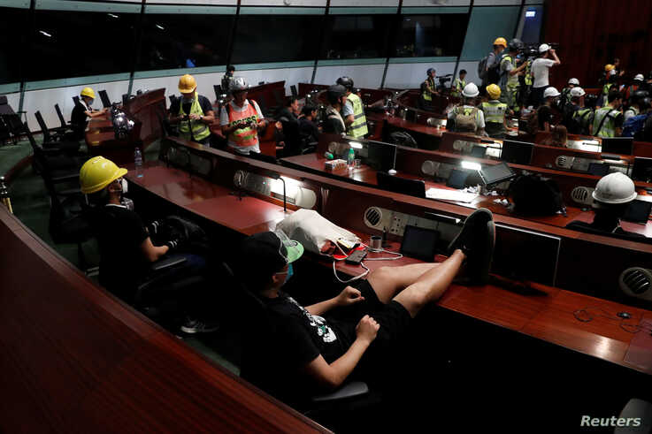 Anti-extradition bill protesters are seen inside a chamber after they broke into the Legislative Council building during the anniversary of Hong Kong's handover to China in Hong Kong, July 1, 2019.