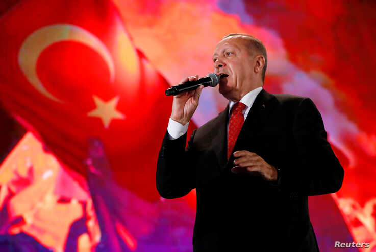 Turkish President Erdogan addresses his supporters during a ceremony marking the third anniversary of the attempted coup at Ataturk Airport in Istanbul, July 15, 2019.