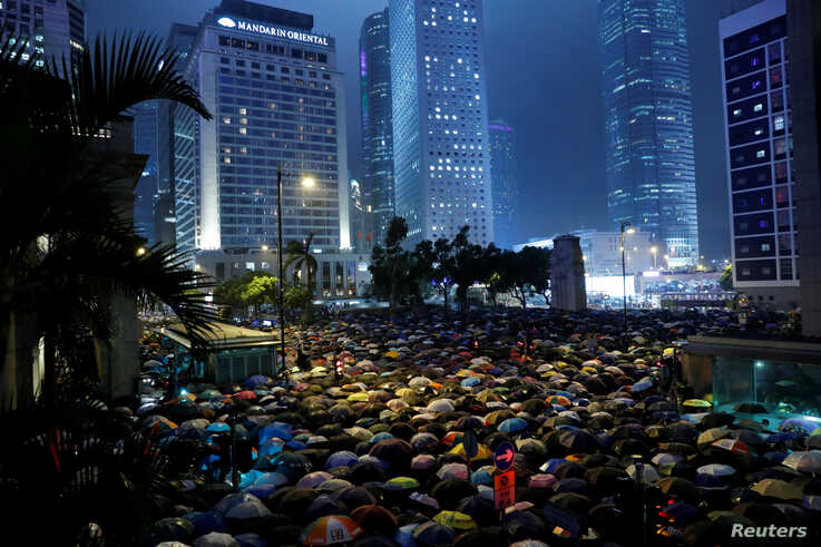 Civil servants attend a rally to support the anti-extradition bill protest in Hong Kong, Aug. 2, 2019.