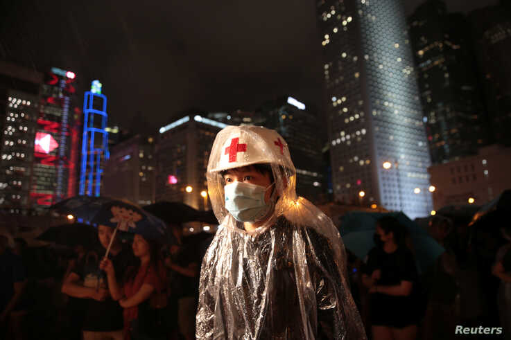 A member of Hong Kong's medical sector attends a rally to support the anti-extradition bill protest in Hong Kong, Aug. 2, 2019.