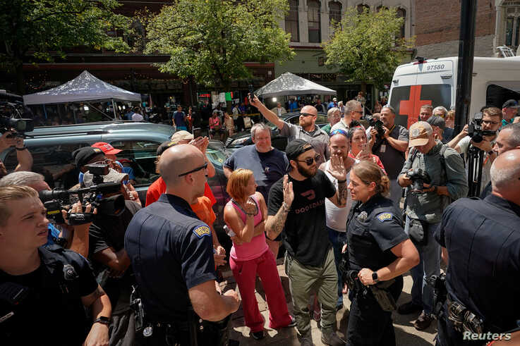 Police separate supporters of U.S. President Donald Trump from those who are opposed to the president during an argument near the site of a mass shooting in Dayton