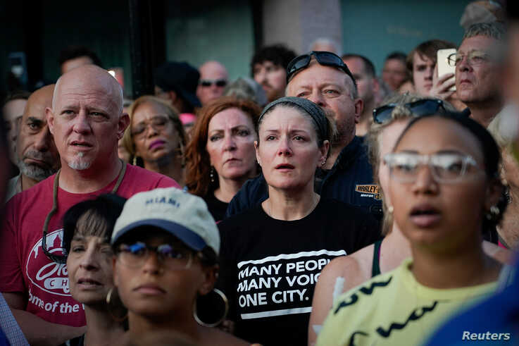 Mourners attend a vigil at the scene after a mass shooting in Dayton, Ohio, Aug. 4, 2019