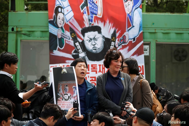 FILE PHOTO: Park Sang-hak, a North Korean defector and leader of an anti-North Korea civic group, speaks as he prepares to release balloons containing leaflets denouncing North Korean leader Kim Jong Un, near the demilitarized zone in Paju