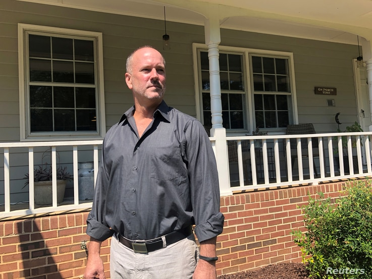 FILE PHOTO: Gerald Bostock, who says he lost his job because he is gay, poses outside his home in Atlanta