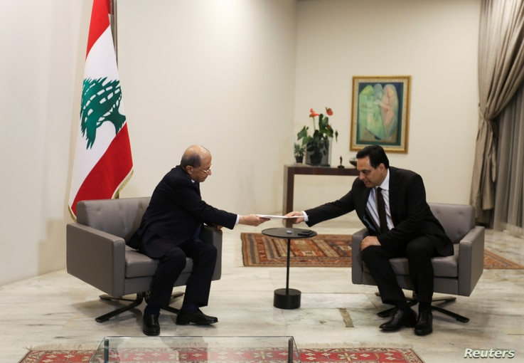 Lebanon's Prime Minister Hassan Diab submits his resignation to Lebanon's President Michel Aoun at the presidential palace in Baabda