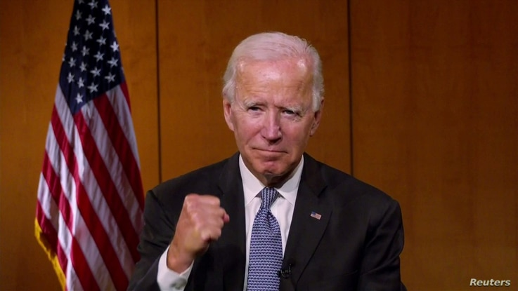 Democratic presidential candidate and former Vice President Joe Biden appears by video feed at start of the all virtual 2020 Democratic Convention hosted from Milwaukee, Wisconsin
