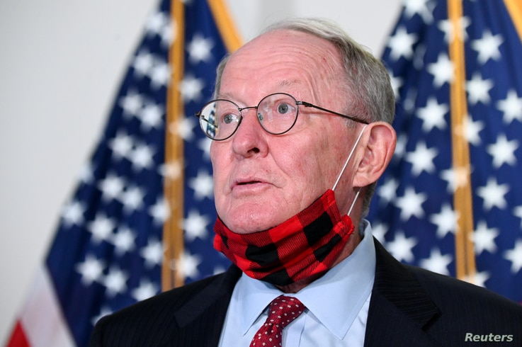 U.S. Senator Alexander speaks to reporters before a luncheon on Capitol Hill in Washington