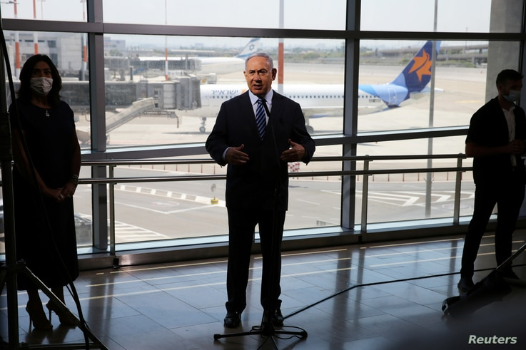 Israeli Prime Minister Benjamin Netanyahu prepares to give a statement at Ben Gurion International Airport, in Lod, near Tel Aviv