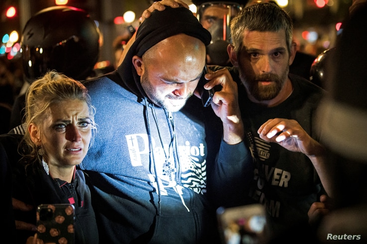 Joey Gibson, leader of the right wing Patriot Prayer group, arrives at the scene of a shooting in Portland