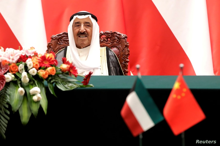 FILE PHOTO: Kuwait's Emir Sheikh Sabah Al-Ahmad Al- Jaber Al-Sabah looks as he witnesses a signing ceremony with Chinese President Xi Jinping at the Great Hall of the People in Beijing