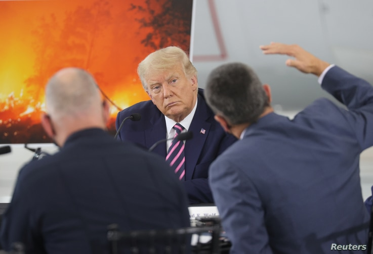 U.S. President Trump participates in a briefing on wildfires in McClellan Park in McClellan Park, California
