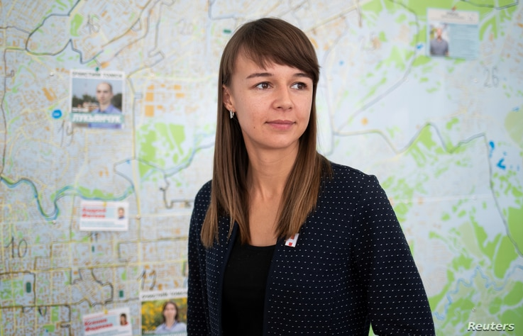 Municipal candidate and Alexei Navalny ally in Tomsk Ksenia Fadeeva poses for a portrait in a local campaign office in Tomsk