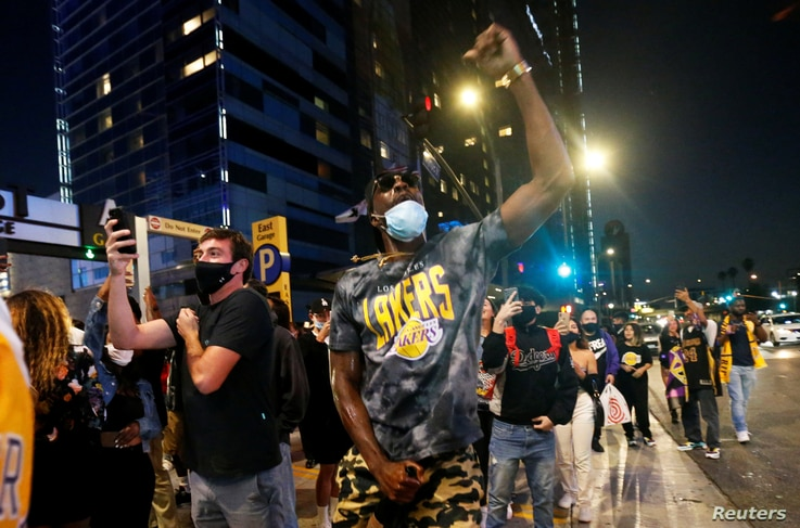 Los Angels Lakers fans celebrate after the Lakers defeated the Miami Heat in Game 6 of the 2020 NBA Finals to win the NBA Championship