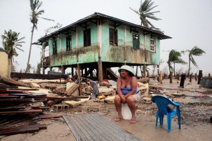 A woman sits near her house damaged the passing of Hurricane Iota, in Puerto Cabezas