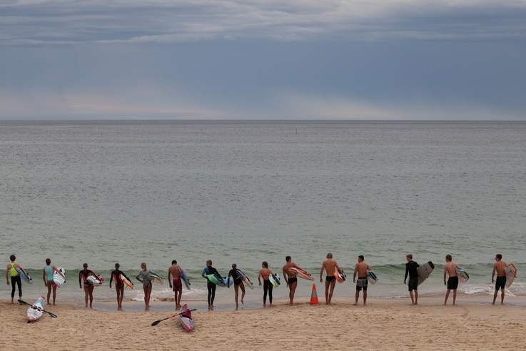 Youths prepare to enter the ocean at Bondi Beach in Sydney