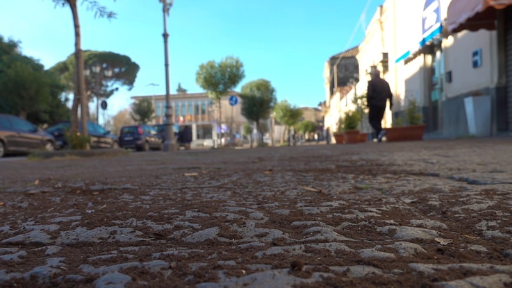 Volcanic ash from Mount Etna covers a village road near Catania