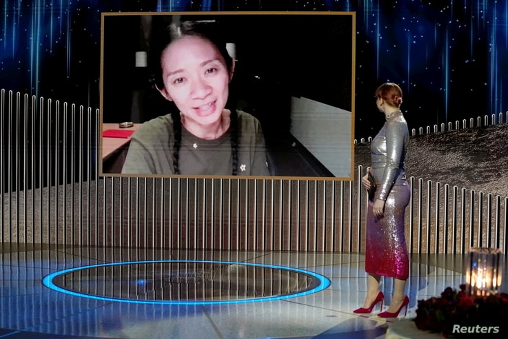 """Chloe Zhao accepts the Best Director - Motion Picture award for """"Nomadland"""" in this handout photo from the 78th Annual Golden Globe Awards in New York"""