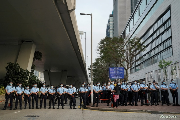 Police officers outside West Kowloon Magistrates' Courts in Hong Kong