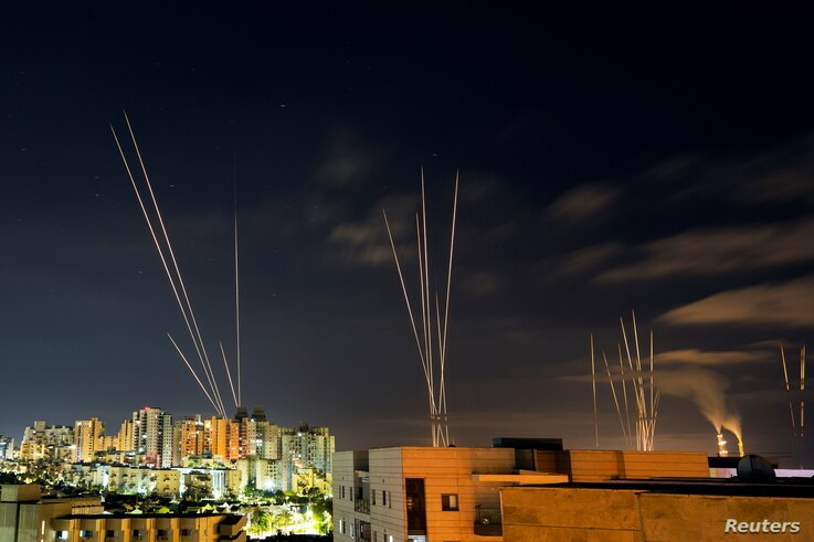 Streaks of light are seen as rockets are launched from the Gaza Strip towards central Israel as seen from Ashkelon, Israel