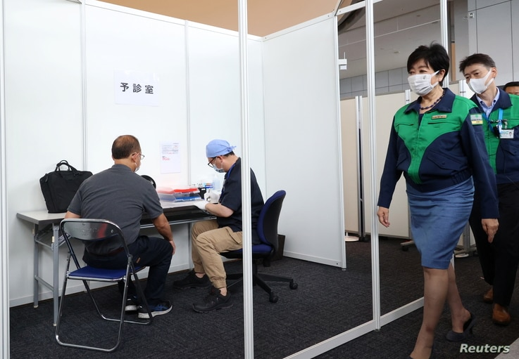 Tokyo Governor Yuriko Koike inspects a vaccination of COVID-19 at the Tokyo Metropolitan Government office in Tokyo