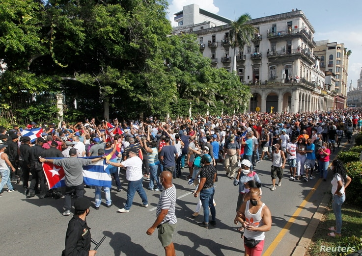 Demonstrators clash during protests against and in support of the government, in Havana
