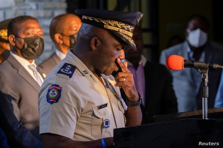 Head of Haitian National Police, Leon Charles, pauses during a news conference in Port-au-Prince
