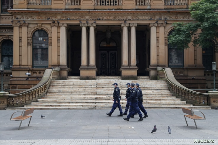 Police look to stop an anti-lockdown protest as a COVID-19 outbreak affects Sydney