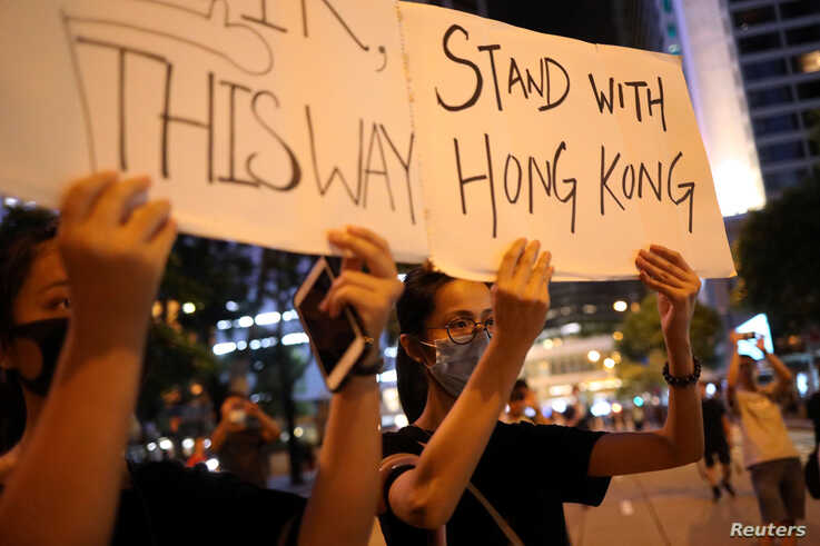 """Protesters attend a """"Stand With Hong Kong, Power to the People Rally"""" at the Chater Garden, in Hong Kong, Aug. 16, 2019."""