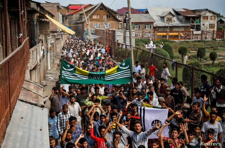 Kashmiri men shout slogans during a protest after the scrapping of the special constitutional status for Kashmir by the Indian government, in Srinagar, August 11, 2019.