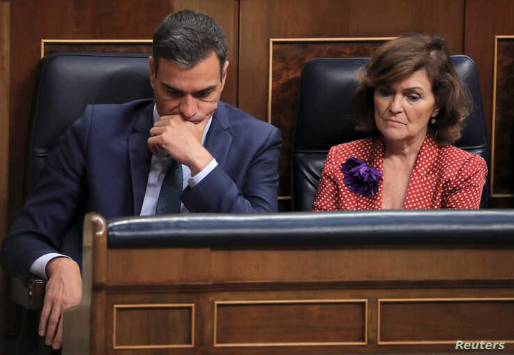 Spain's acting Prime Minister Pedro Sanchez and Deputy Prime Minister Carmen Calvo attend the final day of the investiture debate at the Parliament in Madrid, Spain July 25, 2019. REUTERS/Sergio Perez