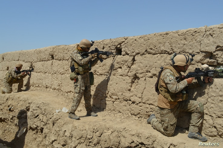 Afghan security forces take position during a battle with the Taliban in Kunduz province, Afghanistan September 1, 2019. REUTERS/Stringer   NO RESALES. NO ARCHIVES
