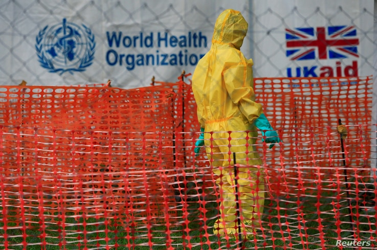 FILE PHOTO: A person dressed in Ebola protective apparel is seen inside an Ebola care facility at the Bwera general hospital near the border with the Democratic Republic of Congo in Bwera, Uganda, June 14, 2019. REUTERS/James Akena/File Photo