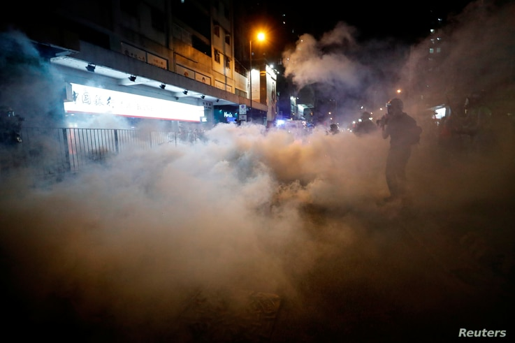 A man is seen after riot police fired tear gas after a sit-in at Yuen Long to protest against violence that happened two months ago when white-shirted men wielding pipes and clubs wounded both anti-government protesters and passers-by, in Hong Kong, China September 21, 2019. REUTERS/Tyrone Siu