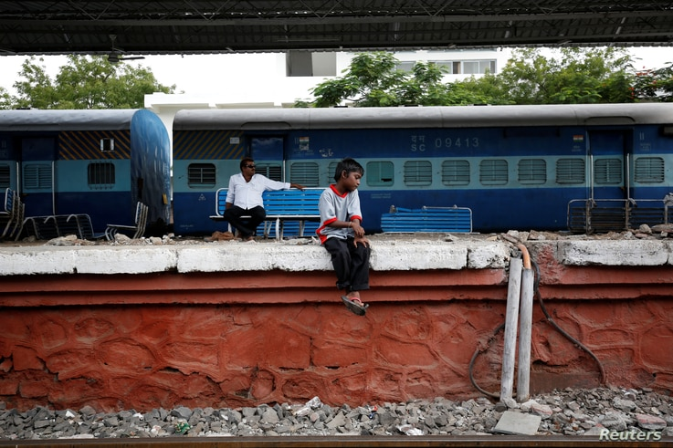 """Siddharth Dhage, 10, waits for the train to arrive after filling his containers with water at Aurangabad railway station, India, July 17, 2019. Dhage is among a small group of children who take a 14 km (9 miles) return train journey from their village in India to fetch water. """"I don't like to spend time bringing water, but I don't have a choice,"""" Dhage said. REUTERS/Francis Mascarenhas  SEARCH """"MASCARENHAS DROUGHT"""" FOR THIS STORY. SEARCH """"WIDER IMAGE"""" FOR ALL STORIES."""