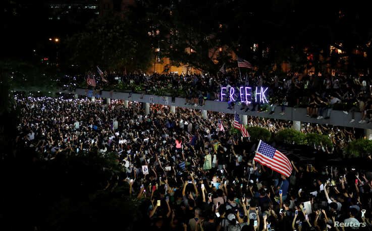 Anti-government demonstrators march in protest against the invocation of the emergency laws in Hong Kong, China, October 14,…