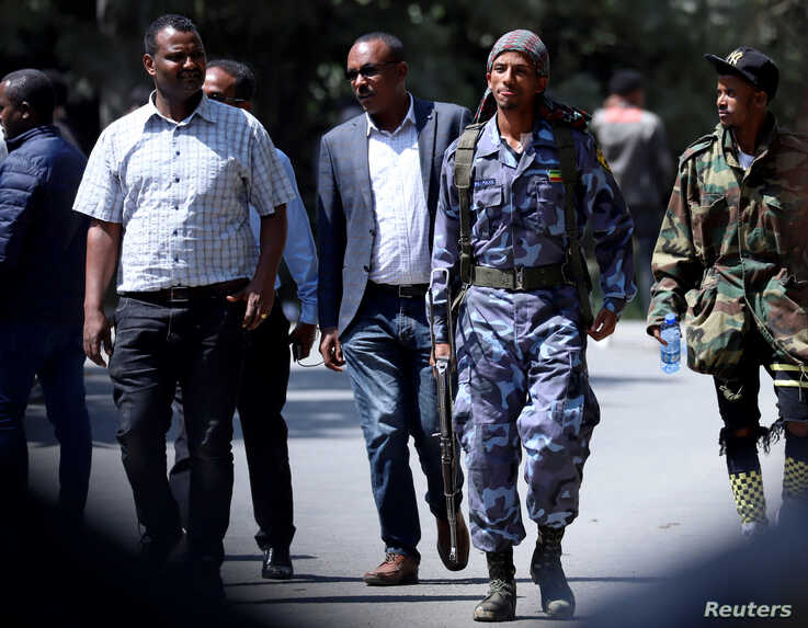 A federal police officer walks outside Jawar Mohammed's house, an Oromo activist and leader of the Oromo protest in Addis Ababa…