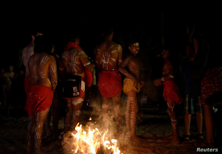 An Aboriginal dance group prepare to perform at Yaama Ngunna Baaka Corroboree Festival on the bank of the Darling River in…
