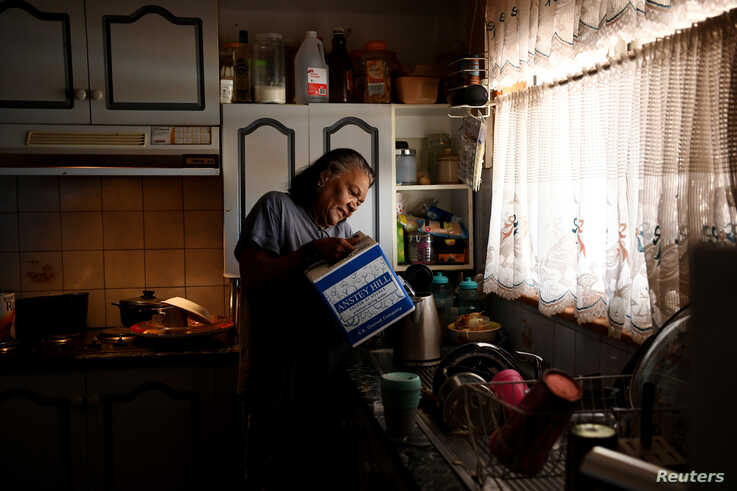 Barkindji elder Patricia Doyle uses boxed water to make a cup of tea at her home in Menindee, New South Wales, Australia,…