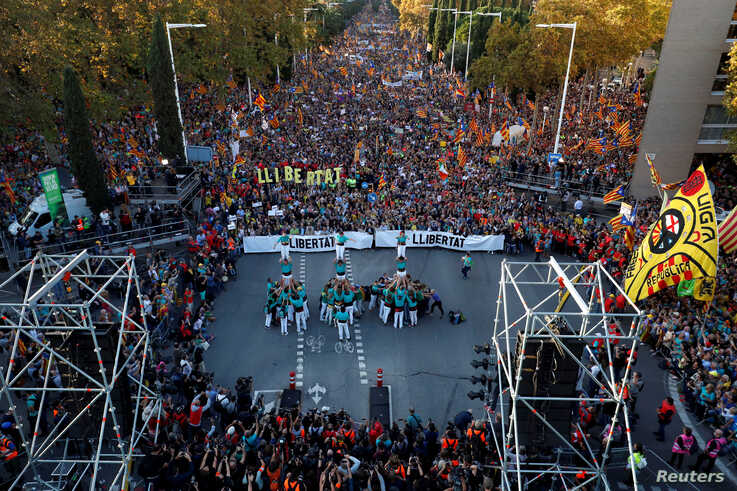 People form human towers as Catalan pro-independence demonstrators attend a protest to call for the release of jailed…