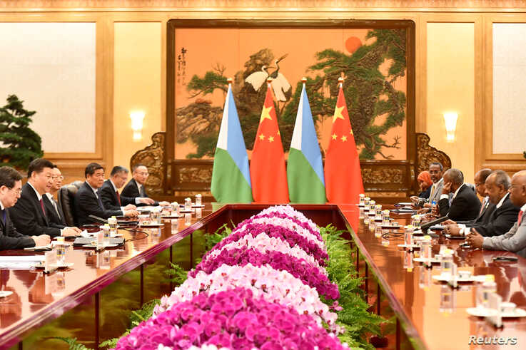 China's President Xi Jinping attends a meeting with Djibouti's President Ismail Omar Guelleh at the Great Hall of the People in…