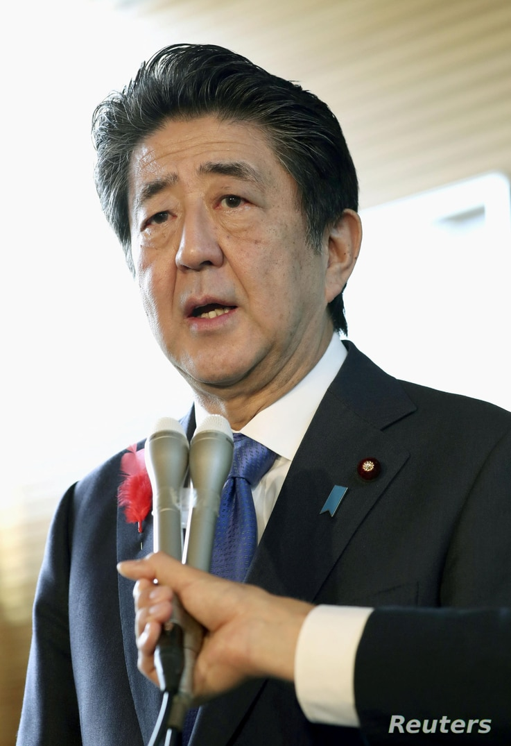 Japan's Prime Minister Shinzo Abe speaks to the media about North Korea's latest launch of ballistic missiles, in Tokyo, Japan, in this photo taken by Kyodo October 2, 2019. Mandatory credit Kyodo/via REUTERS ATTENTION EDITORS - THIS IMAGE WAS PROVIDED BY A THIRD PARTY. MANDATORY CREDIT. JAPAN OUT.