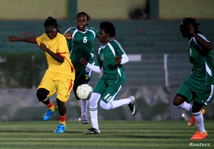 Players of Al-tahadi (green kits) and Al-Difaa (yellow kits) woman soccer teams fight for the ball during Sudan's first women's…