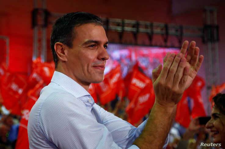 FILE PHOTO: Spain's Socialist leader and acting Prime Minister Pedro Sanchez applauds as he attends a rally to mark the kick…